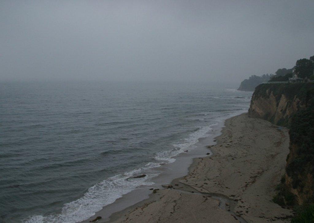 meditation on a rainy beach with acoustic guitar practice