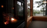 Cozy Fireplace in a Rainstorm